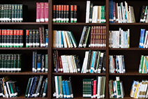 Photograph of a bookshelf with various books